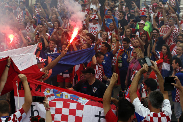 Croatia soccer fans shout chants and cheer prior to a television broadcast of the Russia 2018 World Cup match between France and Croatia in downtown Zagreb, Croatia, Sunday, July 15, 2018. (AP Photo/Darko Vojinovic)