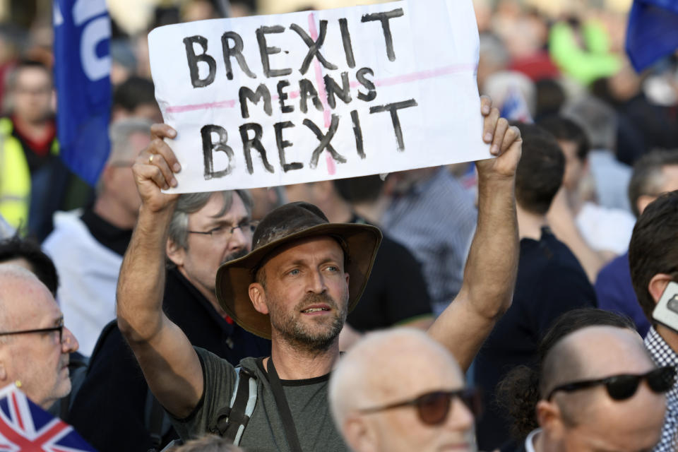 """A protester seen holding a placard that says �Brexit means Brexit"""" during the Leave means leave rally in London. A Leave means leave pro Brexit march begun on March 16 in Sunderland, UK and ended with a rally in Parliament Square on March 29 in London, same day that UK has been scheduled to leave the European Union. Pro Brexit protesters gathered at Parliament Square to demand from the government to deliver what was promised and leave the European Union without a deal. Nigel Farage and Tommy Robinson were seen giving speeches to their supporters in different stages during the pro Brexit protest. (Photo by Andres Pantoja / SOPA Images/Sipa USA)"""