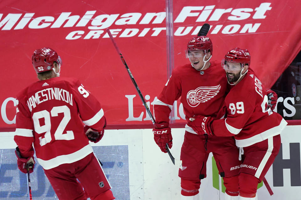 Detroit Red Wings forward Jakub Vrana, second from right, is greeted by centers Sam Gagner (89) and Vladislav Namestnikov (92) after a goal during the second period of the team's NHL hockey game against the Chicago Blackhawks, Thursday, April 15, 2021, in Detroit. (AP Photo/Carlos Osorio)