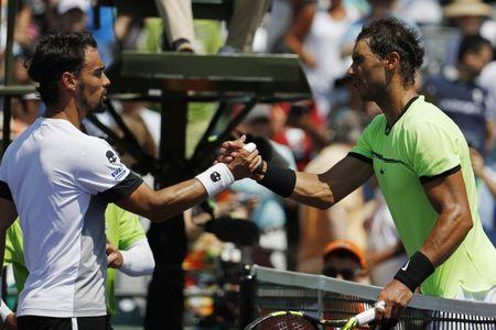 Mar 31, 2017; Miami, FL, USA; Rafael Nadal of Spain (R) shakes hands with Fabio Fognini of Italy (L) after their match during a men's singles semi-final in the 2017 Miami Open at Brandon Park Tennis Center. Nadal won 6-1, 7-5. Mandatory Credit: Geoff Burke-USA TODAY Sports