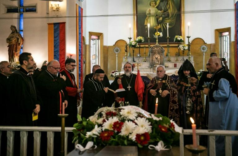 Clerics lead prayers during the funeral of priest Joseph Hanna Ibrahim and his father at the Saint Joseph Church in the Syrian Kurdish-majority city of Qamishli