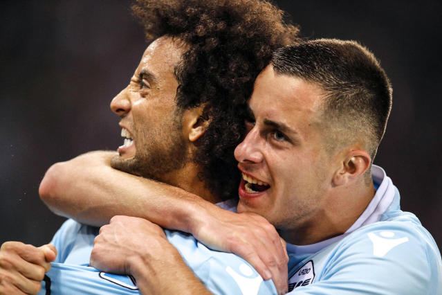 Lazio's Felipe Anderson, left, celebrates with his teammate Adam Marusic after scoring his side's second goal, during the Serie A soccer match between Lazio and Inter Milan at the Rome Olympic Stadium Sunday, May 20, 2018. (Giuseppe Lami/ANSA via AP)