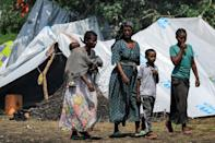 Many Ethiopian refugees are living in basic conditions with plastic sheeting for shelter in Sudan