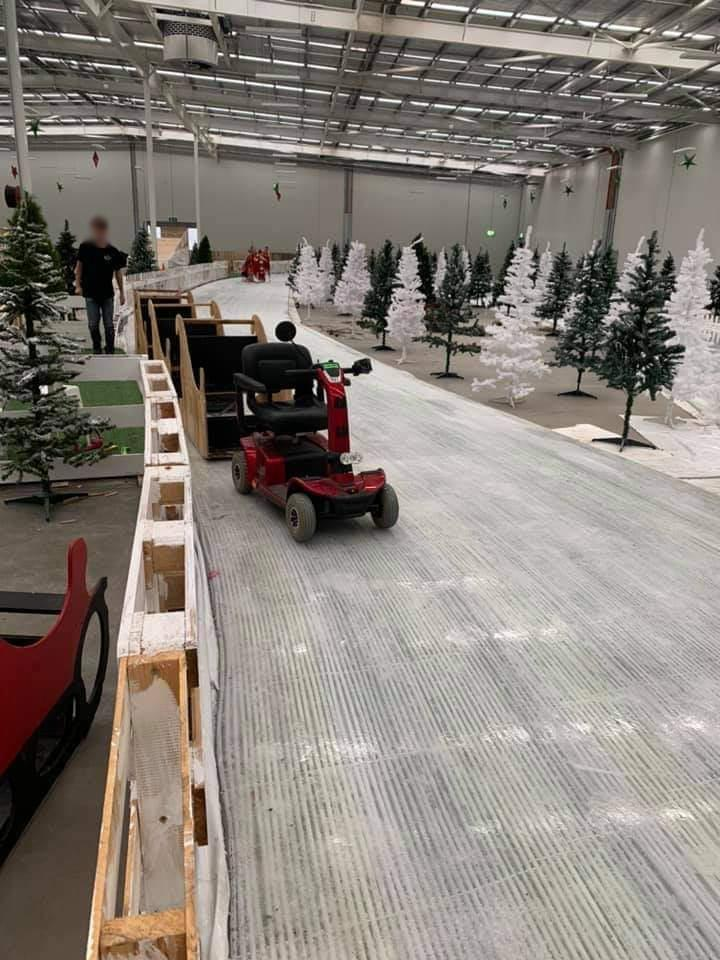 The event's 'Polar Express train ride' was pulled by a mobility scooter. Photo: Twitter.