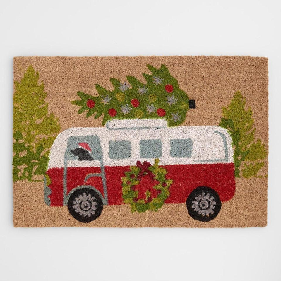 """<p>Set the scene from the moment guests walk in the door with this festive doormat that's sure to make them smile. And priced at just $13, this is one of the most affordable Christmas decorations around. </p> <p><strong>To buy: </strong>$13, <a href=""""http://www.anrdoezrs.net/links/7876406/type/dlg/sid/RS%2C5Under-%252420WaystoGetYourHomeintheHolidaySpirit%2Ckholdefehr1271%2CDEC%2CIMA%2C679457%2C201911%2CI/https://www.worldmarket.com/product/dog-driving-vintage-bus-with-holiday-tree-coir-doormat.do?"""" target=""""_blank"""">worldmarket.com</a>. </p>"""