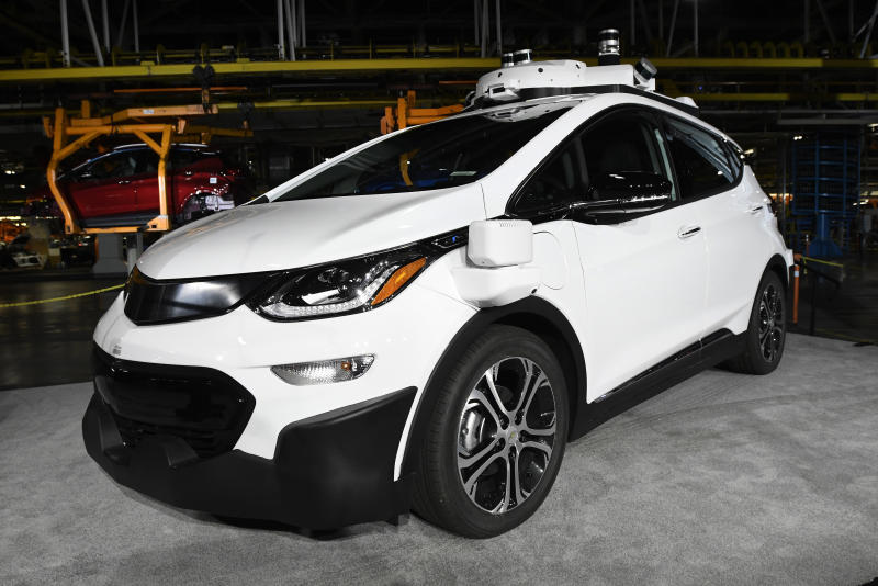 FILE - In this Tuesday, June 13, 2017, file photo, a self-driving Chevrolet Bolt EV that is in General Motors Co.'s autonomous vehicle development program appears on display at GM's Orion Assembly in Lake Orion, Mich. One problem with self-driving cars is people. The Los Angeles Times reports that of six crash reports filed in California in 2018,  two involved a person attacking a robot car. Both incidents happened in San Francisco, according to Department of Motor Vehicles records. (Jose Juarez/Detroit News via AP, File)
