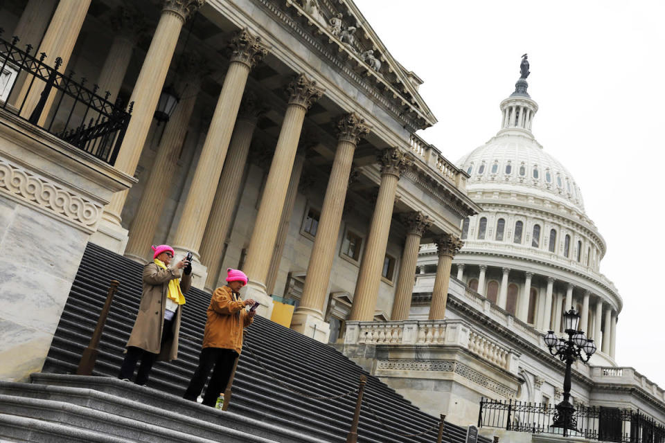 <p>Protesters photograph the crowds from the steps of the Capitol during the Women's March in Washington, D.C. (Photo: Aaron P. Bernstein/Getty Images) </p>