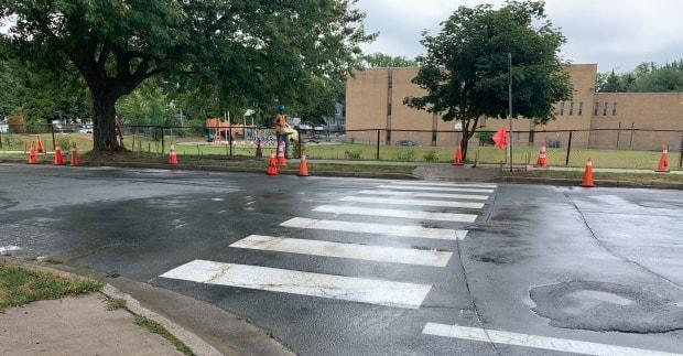 This file image from 2019 shows a white painted crosswalk in Dartmouth, N.S. A number of jurisdictions are reporting shortages in road paint used for crosswalks and other markings. (Paul Palmeter/CBC - image credit)