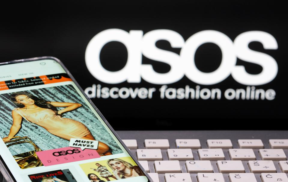 Smartphone with an ASOS app and a keyboard are seen in front of a displayed ASOS logo in this illustration picture taken October 13, 2020. REUTERS/Dado Ruvic/Illustration