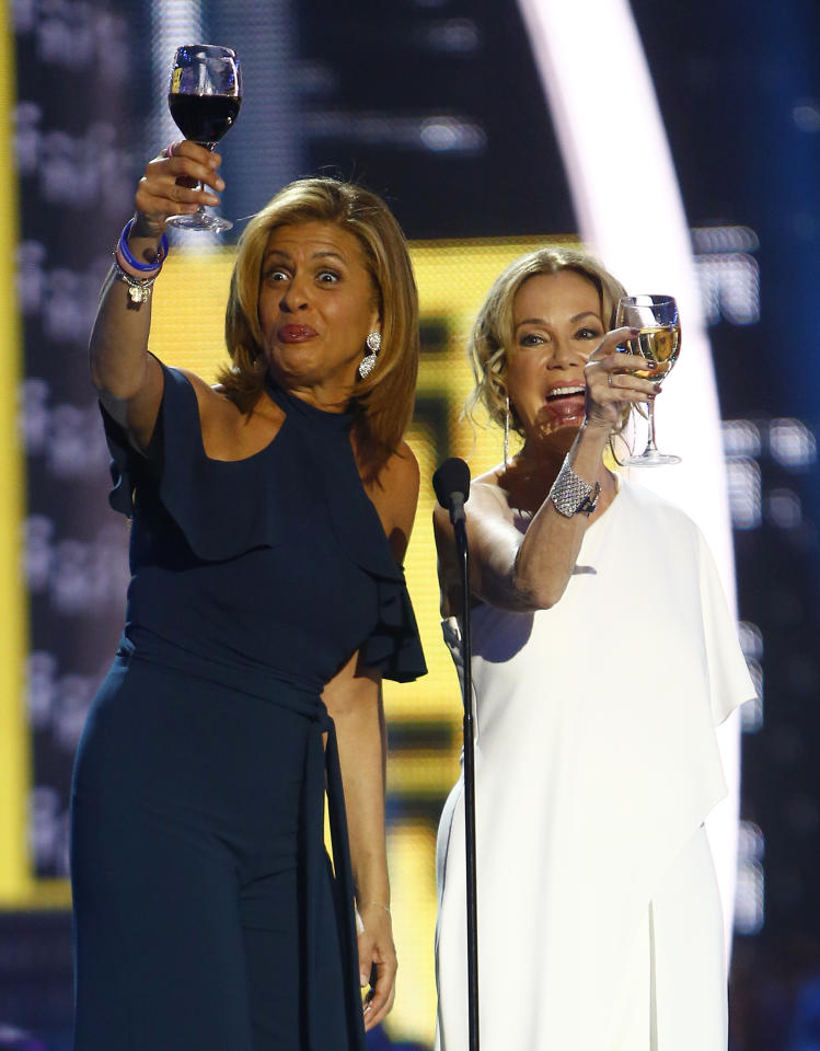Hoda Kotb, left, and Kathie Lee Gifford give a toast as they present the award for CMT performance of the year at the CMT Music Awards at Music City Center on Wednesday, June 7, 2017, in Nashville, Tenn. (Photo by Wade Payne/Invision/AP)