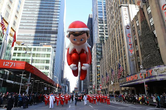 <p>The Elf on the Shelf balloon is led down Sixth Avenue just in time for the holiday season during the 91st Macy's Thanksgiving Day Parade in New York, Nov. 23, 2017. (Photo: Gordon Donovan/Yahoo News) </p>