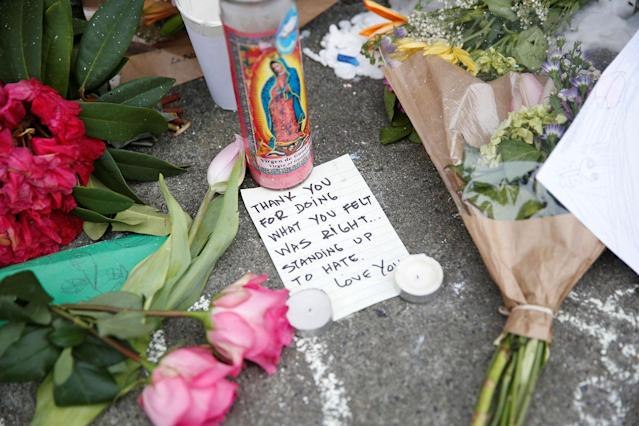<p>A note rests at a makeshift memorial for two men who were killed May 26 on a commuter train while trying to stop another man from harassing two young women who appeared to be Muslim, in Portland, Ore., May 29, 2017. (Terray Sylvester/Reuters) </p>