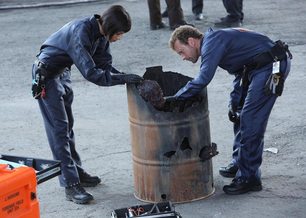 "Cam (Tamara Taylor) and Hodgins (TJ Thyne) investigate remains at a crime scene in ""The Partners in the Divorce"" episode of ""Bones."""