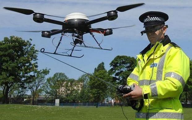 Police aerial surveillance drone...PC Derek Charlton of Merseyside Police operates their new aerial surveillance drone in Liverpool - John Giles