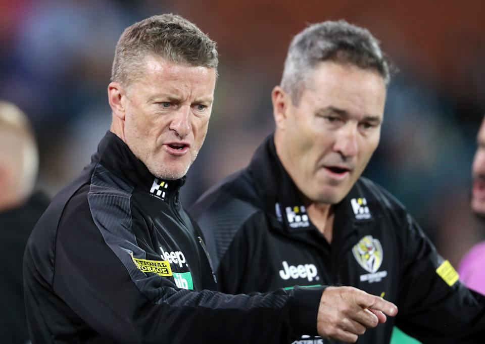 Richmond coach Damien Hardwick points and speaks to his players in Adelaide, Australia.