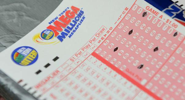 Mega Millions lottery ticket forms at a