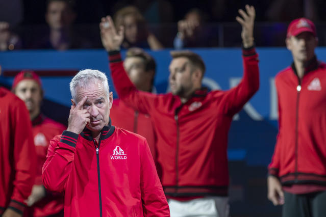Team World's Captain John McEnroe, front, gestures after his team lost the opening match against Team Europe at the Laver Cup tennis event in Geneva, Switzerland, Friday, Sept. 20, 2019. (Martial Trezzini/Keystone via AP)