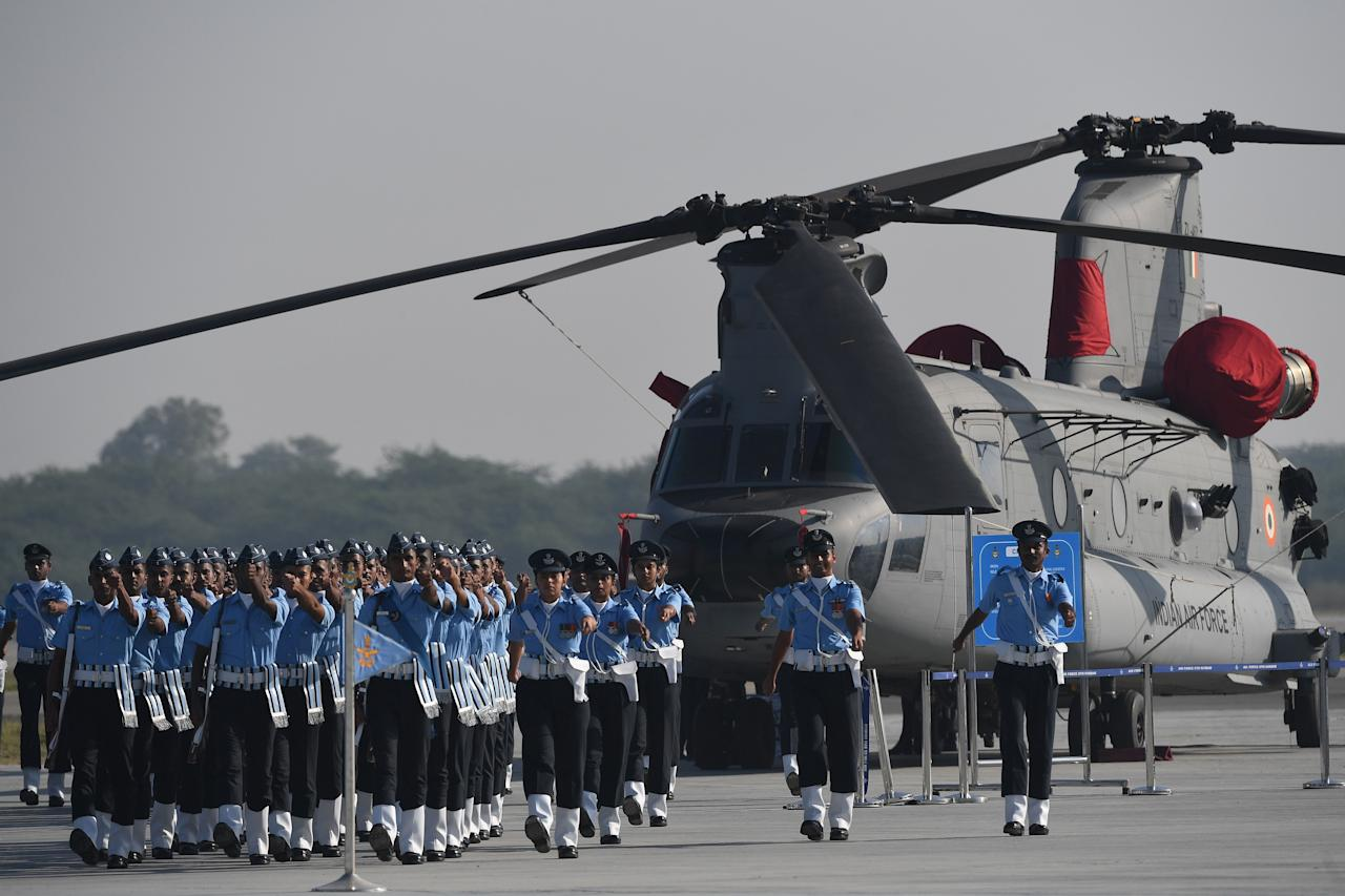 Members of the Indian Air Force (IAF) march during the Air Force Day parade at an IAF station in Ghaziabad, on the outskirts of New Delhi, on October 8, 2019. - The Indian Air Force is celebrating its 87th anniversary. (Photo by Prakash SINGH / AFP) (Photo by PRAKASH SINGH/AFP via Getty Images)