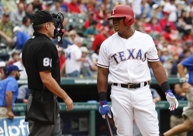 Texas Rangers' Adrian Beltre, right, questions home plate umpire David Rackley (86) after a called third strike during the third inning of a baseball game against the Seattle Mariners, Sunday, Sept. 23, 2018, in Arlington, Texas. (AP Photo/Jim Cowsert)