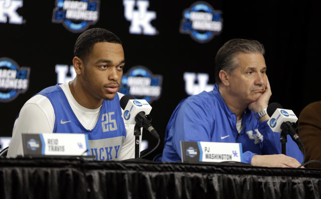 Kentucky's PJ Washington, left, answers a question alongside head coach John Calipari during a news conference at the NCAA tournament college basketball tournament Saturday, March 30, 2019, in Kansas City, Mo. Kentucky is set to play Auburn in the Midwest regional final on Sunday. (AP Photo/Jeff Roberson)