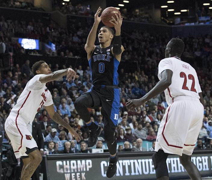Duke forward Jayson Tatum (0) goes to the basket agains Louisville forward Deng Adel (22) and Ray Spalding (13) during the first half of an NCAA college basketball game in the Atlantic Coast Conference tournament, Thursday, March 9, 2017, in New York. (AP Photo/Mary Altaffer)