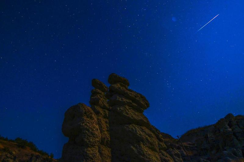 A long exposure photo shows meteor streaks crossing the night sky over the stone dools in Kuklice, near the eastern city of Kratovo,The Former Yugoslav Republic of Macedonia, early August 12, 2017 (EPA)