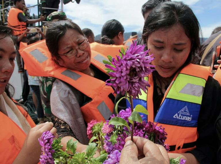 Indonesia rushes to rescue 140 after ferry sinks, killing four