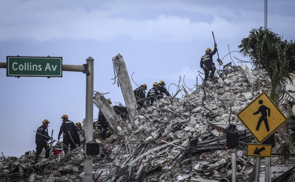 Rescuers search for victims at a collapsed South Florida condo building Monday, July 5, 2021, in Surfside, Fla., after demolition crews set off a string of explosives that brought down the last of the Champlain Towers South building in a plume of dust on Sunday. (Carl Juste/Miami Herald via AP)