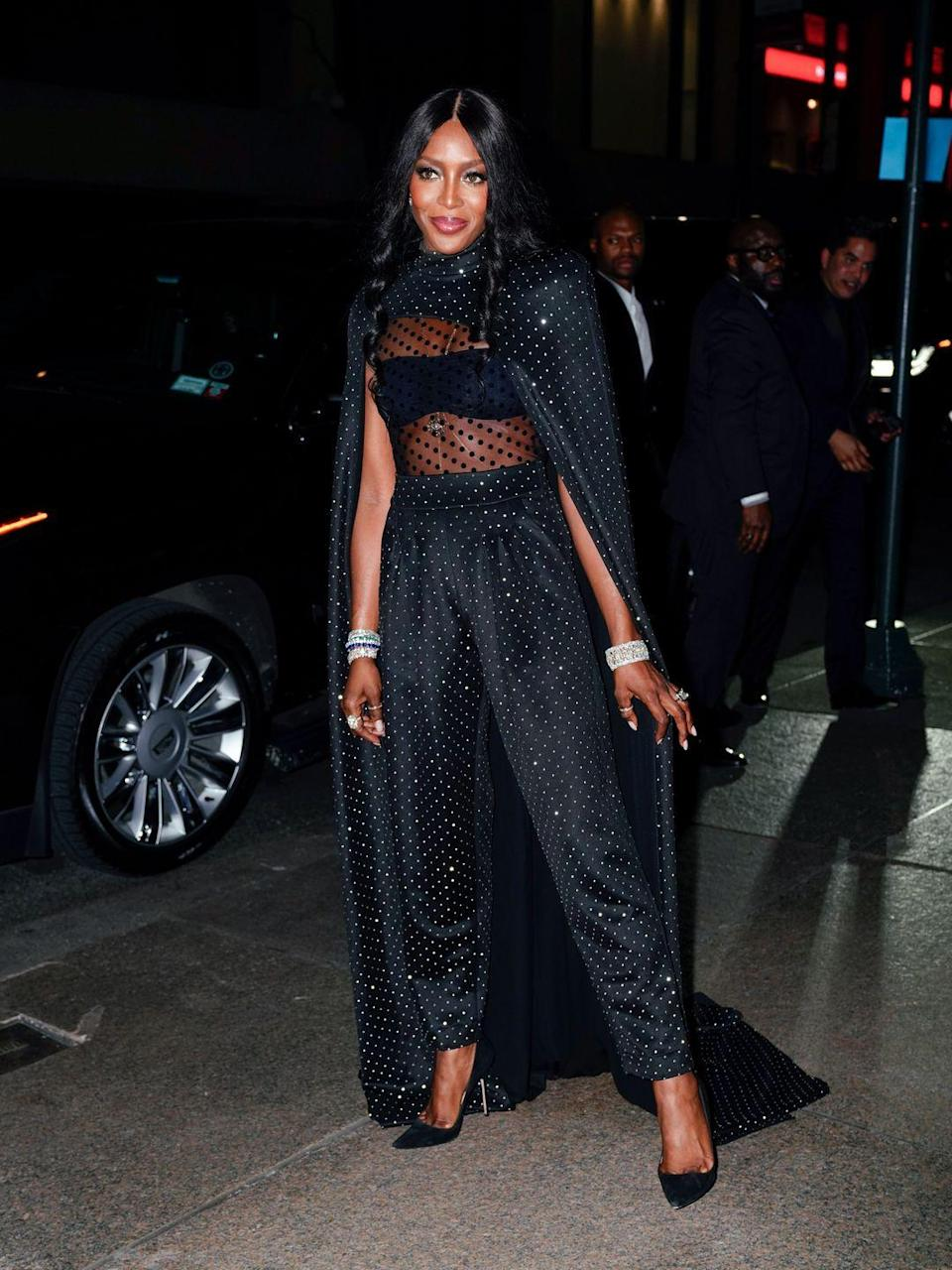 """<p>Naomi Campbell donned a Balmain cape and sheer polka dot bodice for Marc Jacobs' nuptials and looked incredible, debunking the <a href=""""https://www.cosmopolitan.com/uk/fashion/style/a35829/how-to-wear-black-to-a-wedding-dresses/"""" rel=""""nofollow noopener"""" target=""""_blank"""" data-ylk=""""slk:'you can't wear black to a wedding' myth"""" class=""""link rapid-noclick-resp"""">'you can't wear black to a wedding' myth</a>.</p>"""