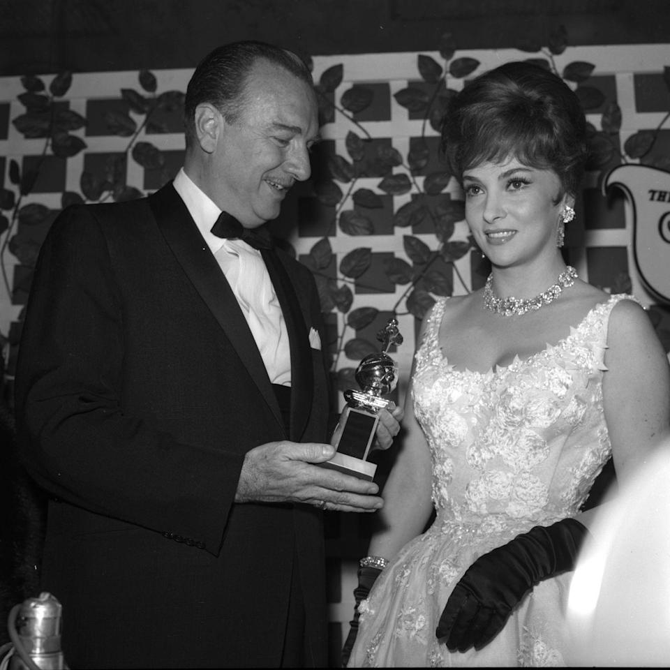<p>Actress Gina Lollobrigida looked like royalty at the 1961 red carpet in this ball gown style dress adorned with glamorous gloves and blinding jewels. </p>