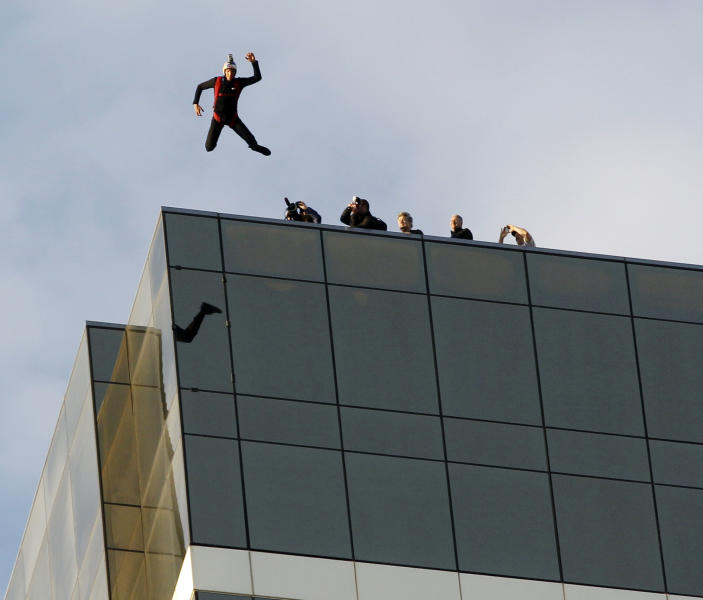 Base jumper Jeff Provenzano leaps off the top of the The Water Club hotel in Atlantic City, N.J., Wednesday, Feb. 29, 2012. People jumped off tall buildings all around the country Wednesday, but no one got hurt. It was all part of a Leap Day promotion being filmed for an energy drink commercial. In Atlantic City, two parachutists jumped off the top of The Water Club, the Borgata's luxury hotel, and landed safely in the parking lot. Similar jumps were planned in Miami, Detroit, Las Vegas and other cities.(AP Photo/Mel Evans)