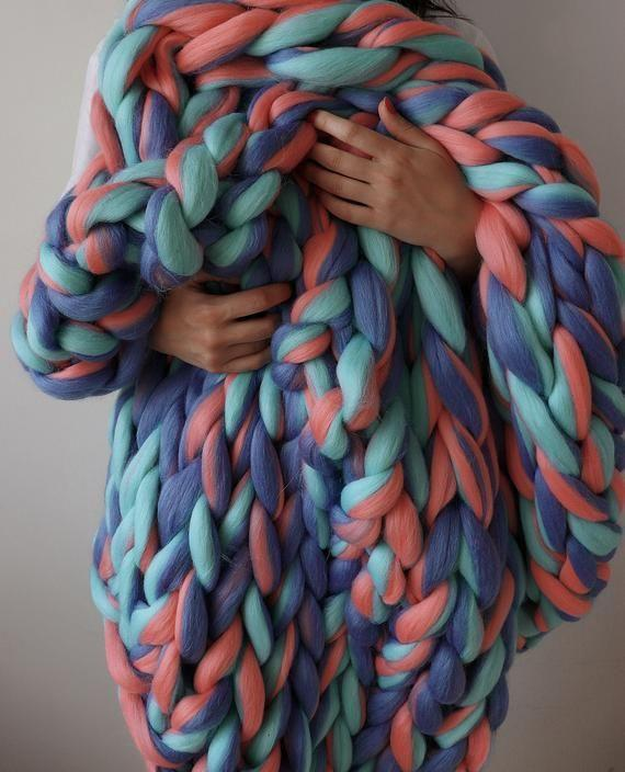 """<p><strong>WoolHugs</strong></p><p>etsy.com</p><p><strong>$172.50</strong></p><p><a href=""""https://go.redirectingat.com?id=74968X1596630&url=https%3A%2F%2Fwww.etsy.com%2Flisting%2F506245288%2Fchunky-knit-blanket-large-knit-blanket&sref=https%3A%2F%2Fwww.seventeen.com%2Flife%2Ffriends-family%2Fg30140775%2Fgifts-for-mom-from-daughter%2F"""" rel=""""nofollow noopener"""" target=""""_blank"""" data-ylk=""""slk:Shop Now"""" class=""""link rapid-noclick-resp"""">Shop Now</a></p><p>Now that you're spending 24/7 at home, cute blankets are a necessity.</p>"""