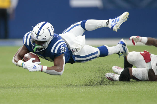Indianapolis Colts running back Nyheim Hines (21) is tackled by Atlanta Falcons free safety Ricardo Allen (37) during the first half of an NFL football game, Sunday, Sept. 22, 2019, in Indianapolis. (AP Photo/AJ Mast)