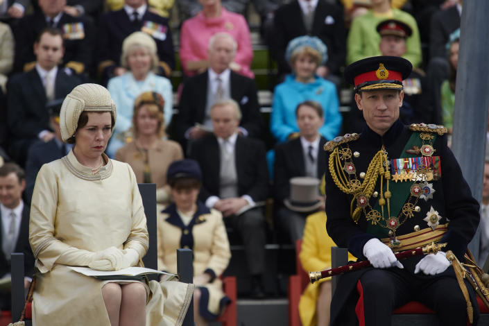 "In this image released by Netflix, Olivia Colman plays Queen Elizabeth II and Tobias Menzies portrays Prince Philip in a scene from the third season of ""The Crown."" Britain's Prince Philip stood loyally behind behind Queen Elizabeth, as his character does on Netflix's ""The Crown."" But how closely does the TV character match the real prince, who died Friday, April 9, 2021 at 99? Philip is depicted as a man of action in ""The Crown,"" and he served with distinction in the navy in World War II. He was also an avid yachtsman and polo player.(Des Willie/Netflix via AP)"