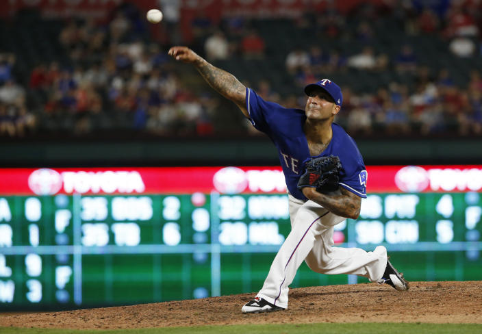 FILE - In this May 24, 2018 file photo, Texas Rangers relief pitcher Matt Bush delivers against the Kansas City Royals during the seventh inning of a baseball game in Arlington, Texas. Veteran pitchers Bush and Ian Kennedy will break from the Texas Rangers spring training camp as top options in the back end of the bullpen. Bush has had surgery twice on his right elbow since his last big league appearance in 2018. (AP Photo/Ron Jenkins, File)