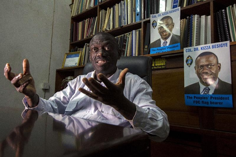Kizza Besigye has told AFP in an interview in his office that he has had to challenge President Yoweri Museveni in order to see change in Uganda (AFP Photo/Isaac Kasamani)