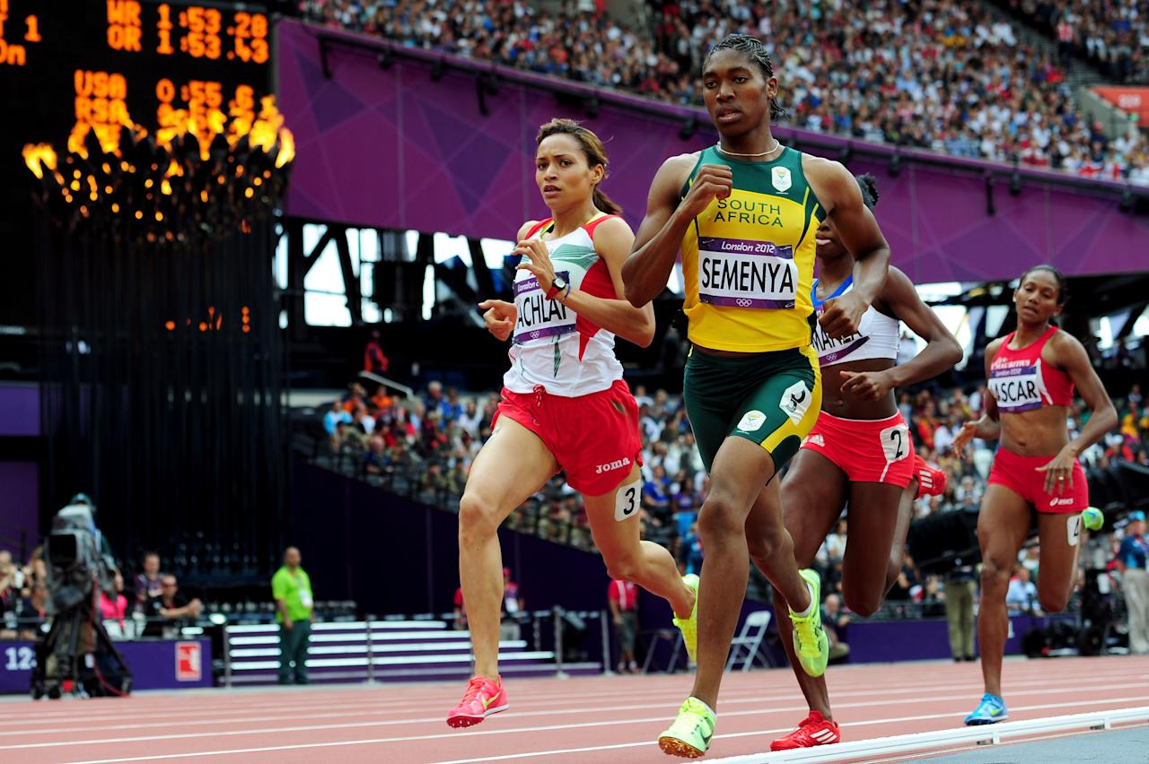 LONDON, ENGLAND - AUGUST 08:  (L-R) Halima Hachlaf of Morocco (L) and Caster Semenya of South Africa compete in the Women's 800m Round 1 Heats on Day 12 of the London 2012 Olympic Games at Olympic Stadium on August 8, 2012 in London, England.  (Photo by Stu Forster/Getty Images)