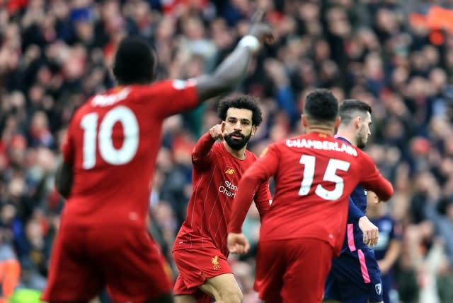 Mohamed Salah, centre, celebrates his 70th Premier League goal for Liverpool on his 100th top-flight appearance for the club during March's 2-1 win over Bournemouth. His low strike made him the first Reds player since Michael Owen in 2002-03 to score 20-plus goals in all competitions in three successive seasons (Mike Egerton/PA)
