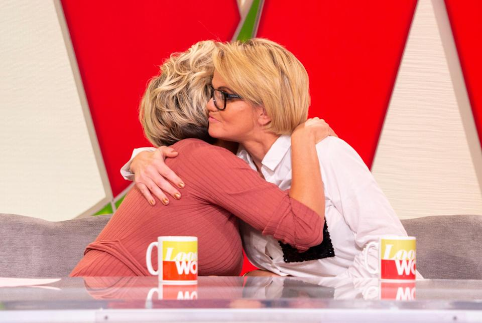 Kerry Katona and Danniella Westbrook embrace after a frank interview on suicide and mental health. (REX)