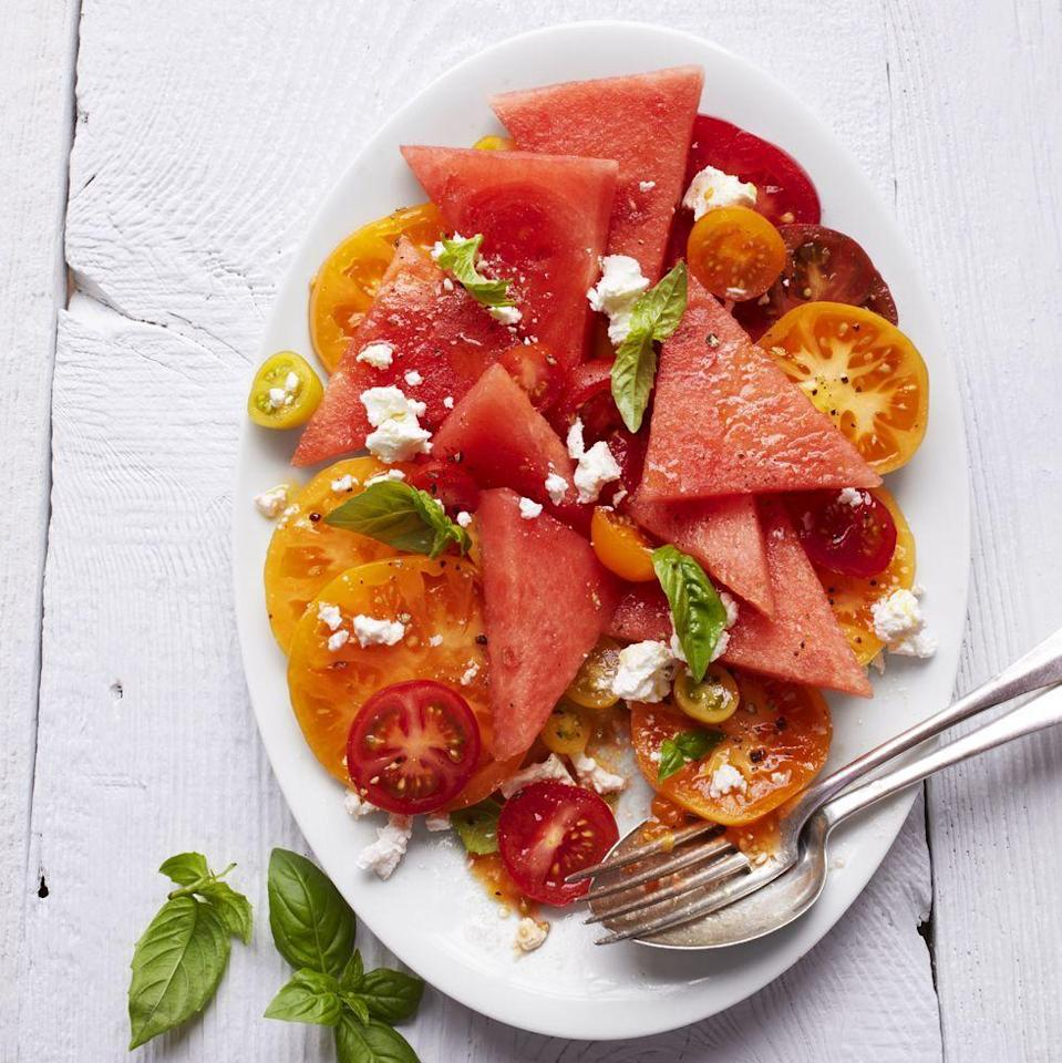 """<p>Tomato and watermelon may sound like an unlikely duo, but when they team up with basil, feta, and olive oil, the result is a mouth-watering side dish. </p><p><strong><em><a href=""""https://www.womansday.com/food-recipes/a32934915/tomato-and-watermelon-salad-recipe/"""" rel=""""nofollow noopener"""" target=""""_blank"""" data-ylk=""""slk:Get the recipe for Tomato and Watermelon Salad"""" class=""""link rapid-noclick-resp"""">Get the recipe for Tomato and Watermelon Salad</a>.</em></strong> </p>"""