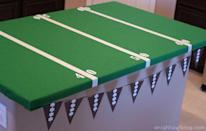 "<p>This table cloth will take your party decorations to the next level — and it will also make clean up a lot easier.</p><p><em><a href=""https://www.anightowlblog.com/easy-football-field-party-table/"" rel=""nofollow noopener"" target=""_blank"" data-ylk=""slk:Get the tutorial at A Night Owl Blog »"" class=""link rapid-noclick-resp"">Get the tutorial at A Night Owl Blog »</a></em> </p>"