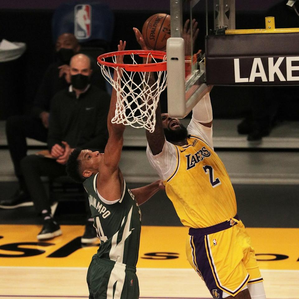 Lakers Andre Drummond drives to the basket against Milwaukee Bucks forward Giannis Antetokounmpo.