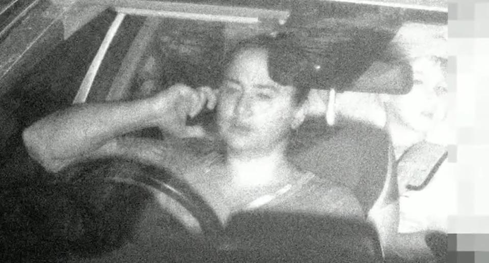 A mobile phone camera snaps a photo of Steff Doney while she is driving.