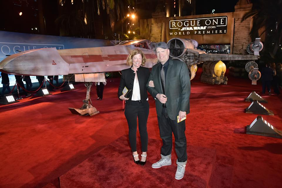 """HOLLYWOOD, CA - DECEMBER 10: President of Marvel Studios Kevin Feige (R) and Caitlin Feige attend The World Premiere of Lucasfilm's highly anticipated, first-ever, standalone Star Wars adventure, """"Rogue One: A Star Wars Story"""" at the Pantages Theatre on December 10, 2016 in Hollywood, California.  (Photo by Marc Flores/Getty Images for Disney)"""