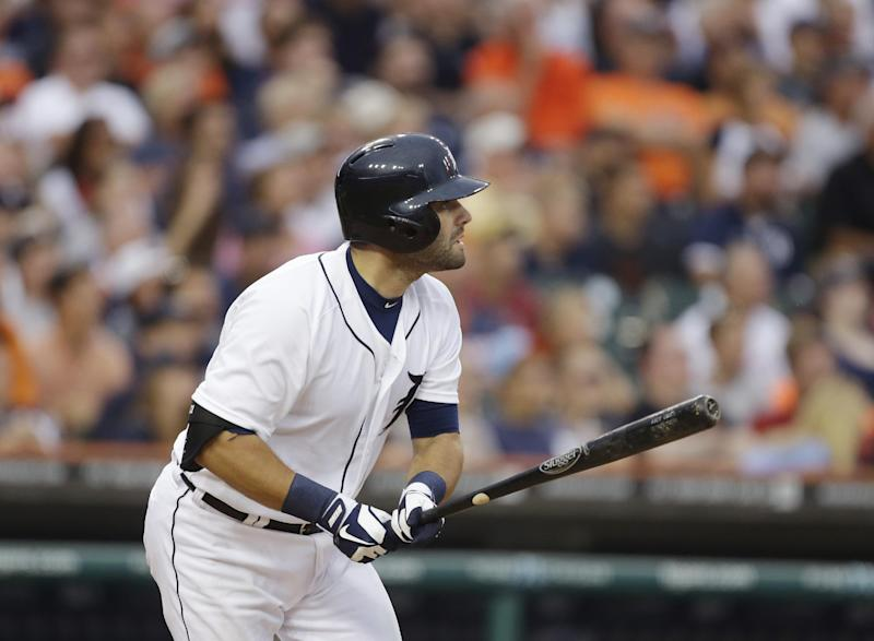 Detroit Tigers' Alex Avila watches his two-run double to Philadelphia Phillies center fielder John Mayberry during the fifth inning of a baseball game in Detroit, Friday, July 26, 2013. (AP Photo/Carlos Osorio)