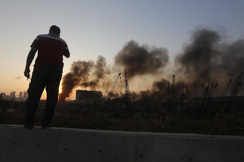 BEIRUT, LEBANON - AUGUST 04: Smoke rises from a port facility after large explosions on August 4, 2020 in Beirut, Lebanon. At least 50 people were killed and thousands more injured when two explosions occurred near the Lebanese capital's port area. (Photo by Marwan Tahtah/Getty Images)