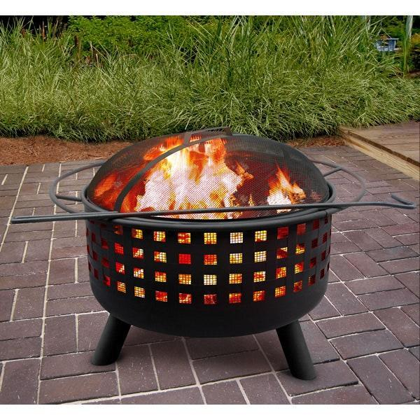 """Light shines through the decorative cutouts in this steel fire pit that converts into a grill. The versatile unit comes complete with a spark screen, cooking grate, and poker. It also has a safety handle, which makes it easy to transport. $185, Woodland Direct. <a href=""""https://www.woodlanddirect.com/City-Lights-Memphis-Fire-Pit-Black"""" rel=""""nofollow noopener"""" target=""""_blank"""" data-ylk=""""slk:Get it now!"""" class=""""link rapid-noclick-resp"""">Get it now!</a>"""