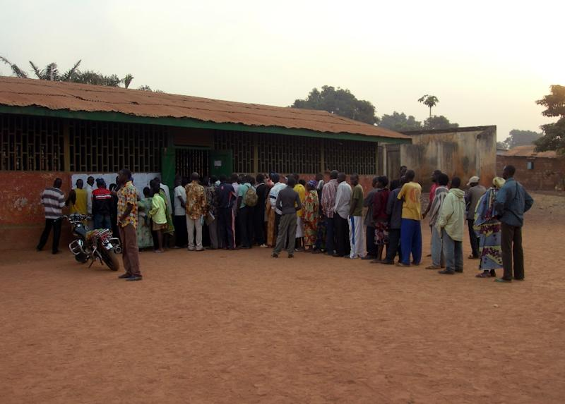 People queue to vote on January 23, 2011 at a polling station in the school of Bangui