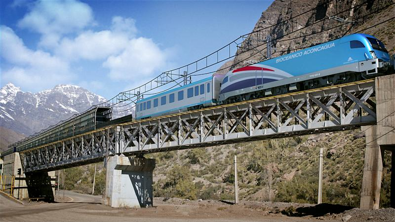 In this computer generated image released by Bi-Oceanico Corridor, a miniature model of a train for the proposed Aconcagua Bi-Oceanico Corridor is seen on a bridge in the Andes mountains. Two of South America's leading economies are neighbors but might as well be worlds apart, separated by a mountain wall with only one major land crossing that gets snowed in for up to two months every winter. An ambitious effort to build a private railway under Andean peaks aims to end the bottleneck. (AP Photo/Bi-Oceanico Corridor)