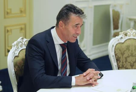 NATO Secretary General Rasmussen speaks during his meeting with Ukraine's Prime Minister Yatseniuk in Kiev